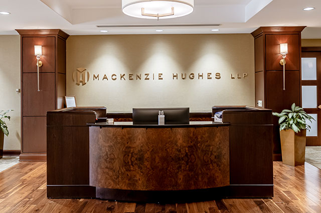 desk in the lobby of the Mackenzie Hughes Law Offices
